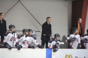 Hawks coach Terry Jones, standing on the bench during the KIJHL championship last season, took matters into his own hands this weekend in Trail, standing in front of the bus of the Trail Smoke Eaters to protest the fact the BCHL staff would not release Ryan Edwards.  The Nelson Daily file photo